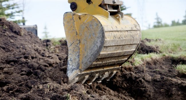 A Backhoe Digging a Trench
